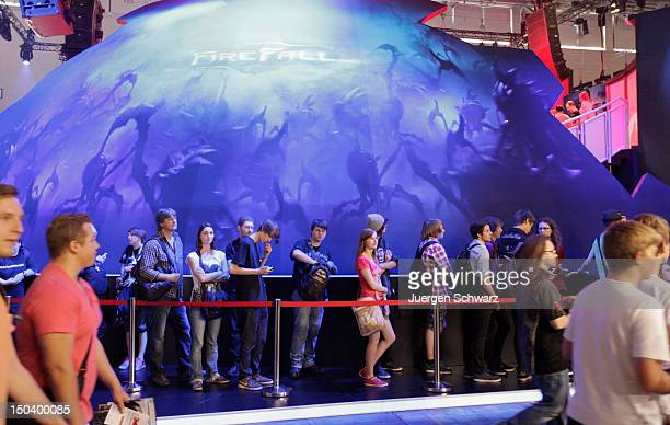 Gaming enthusiasts line up before playing Firefall at the Gamescom 2012 gaming trade fair on August 16 2012 in Cologne Germany Gamescom is Europe's...