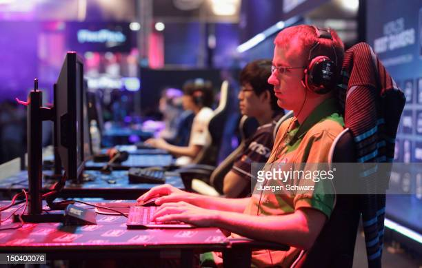 Gaming enthusiasts play World of Warcraft at the Gamescom 2012 gaming trade fair on August 16 2012 in Cologne Germany Gamescom is Europe's largest...