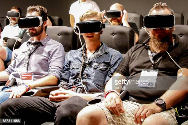 Gaming enthusiasts try out a virtual reality game at the Gamescom 2017 gaming trade fair on August 22 2017 in Cologne Germany Gamescom is the world's...