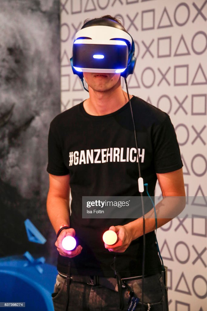 A gaming enthusiasts try out a virtual reality game at the Gamescom 2017 gaming trade fair on August 22, 2017 in Cologne, Germany. Gamescom is the world's largest digital gaming trade fair and will be open to the public from August 22-26.