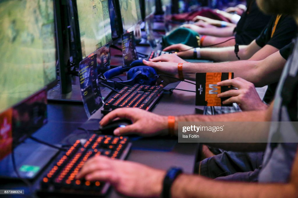 Gaming enthusiasts try out a virtual reality game at the Gamescom 2017 gaming trade fair on August 22, 2017 in Cologne, Germany. Gamescom is the world's largest digital gaming trade fair and will be open to the public from August 22-26.