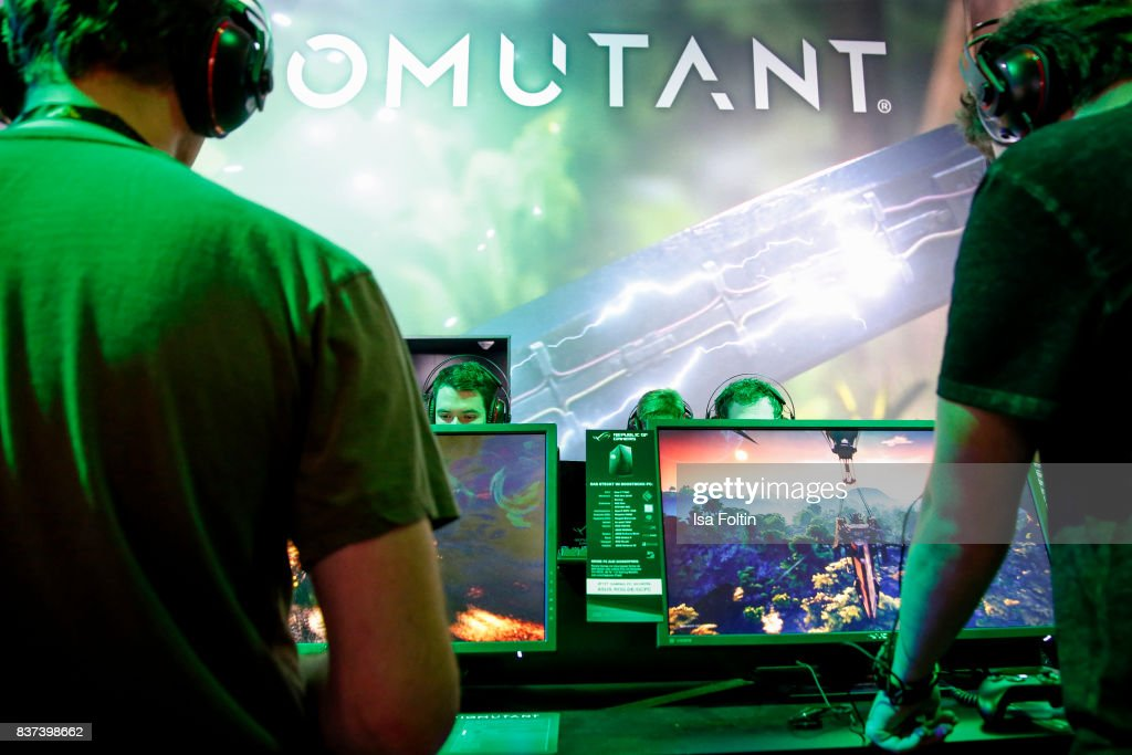Gaming enthusiasts try out the virtual reality game 'Biomutant' at the Gamescom 2017 gaming trade fair on August 22, 2017 in Cologne, Germany. Gamescom is the world's largest digital gaming trade fair and will be open to the public from August 22-26.
