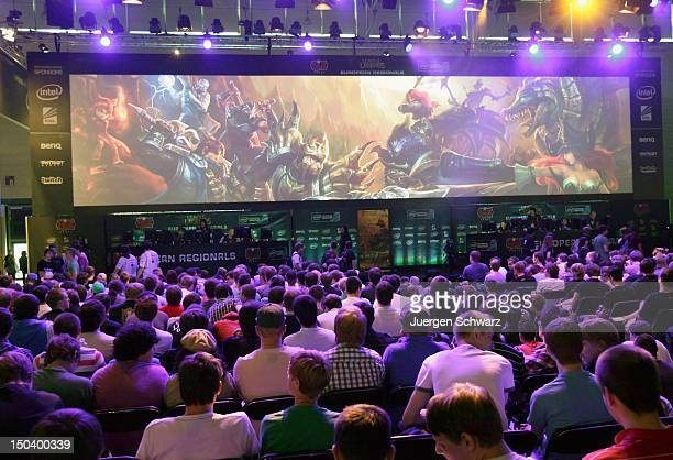 Gaming enthusiasts watch a League of Legends game 3 at the Gamescom 2012 gaming trade fair on August 16 2012 in Cologne Germany Gamescom is Europe's...