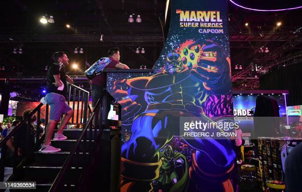 A gaming fan plays Capcom's Marvel Super Heroes on a giant arcade console at the 2019 Electronic Entertainment Expo also known as E3 opening in Los...