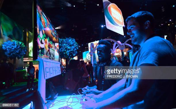 Gaming fans play Bandai Namco's 'Dragon Ball Z' on day two of E3 2017 the three day Electronic Entertainment Expo at the Los Angeles Convention...