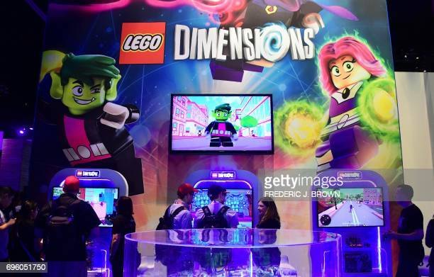 Gaming fans play 'Lego Dimensions' on day two of E3 2017 the three day Electronic Entertainment Expo at the Los Angeles Convention Center in Los...