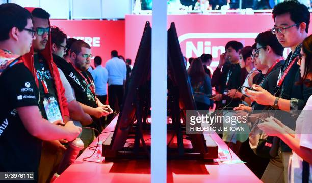 Gaming fans play Super Smash Bros on Nintendo Switch at the 24th Electronic Expo or E3 2018 in Los Angeles California on June 13 2018 where hardware...