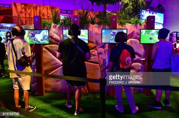Gaming fans play the game 'Fortnite' at the 24th Electronic Expo or E3 2018 in Los Angeles California on June 13 where hardware manufacturers...