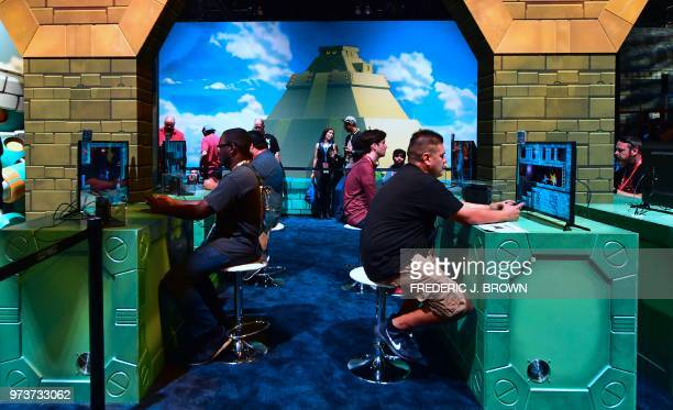 Gaming fans play the game 'Mega Man 11' at the 24th Electronic Expo or E3 2018 in Los Angeles California on June 13 where hardware manufacturers...
