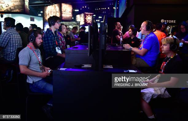 Gaming fans play 'Tom Clancy's The Division 2' at the 24th Electronic Expo or E3 2018 in Los Angeles California on June 13 where hardware...