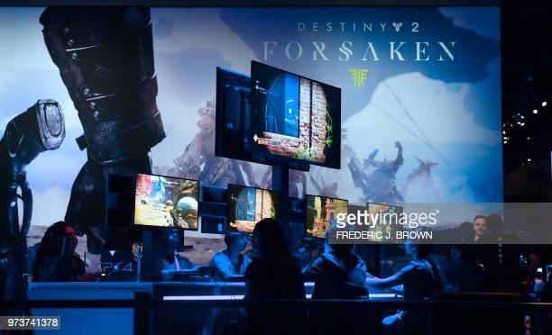 GAming fans plays 'Destiny 2 Forsaken' at the 24th Electronic Expo or E3 2018 in Los Angeles California on June 13 where hardware manufacturers...