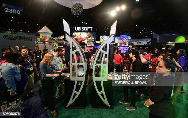 Gaming fans sample Ubisoft's 'Harvest Moon Light of Hope' and 'River City Rival Showdown' on day two of E3 2017 the three day Electronic...