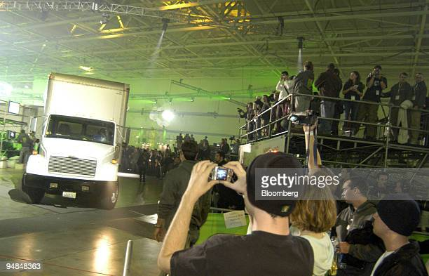 Gaming fans watch as Microsoft Corp.'s new Xbox 360 vide-game console is brought in in trucks to be distributed to buyers at the Zero Hour event in...