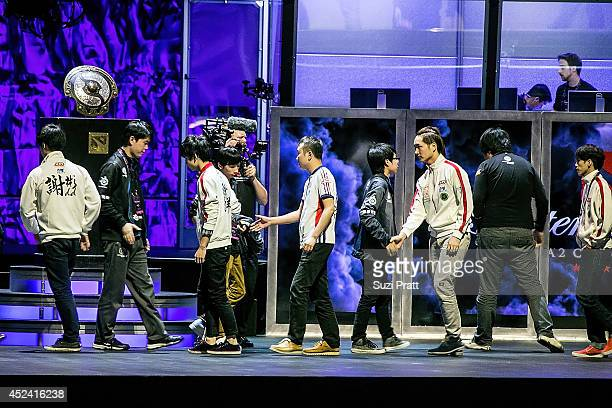 Gaming led by captain Yao walks on stage following a win at The International DOTA 2 Champsionships at Key Arena on July 19 2014 in Seattle Washington
