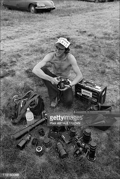 Gamma photographer Michel Artault displays his black Leicaflex cameras with their motor drives and range of lenses at the Circuit de la Sarthe during...