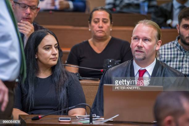 Gamze Kubasik daughter of murdered Mehmet Kubasik sits in a courtroom next to her lawyer before the proclamation of sentence in the trial against...