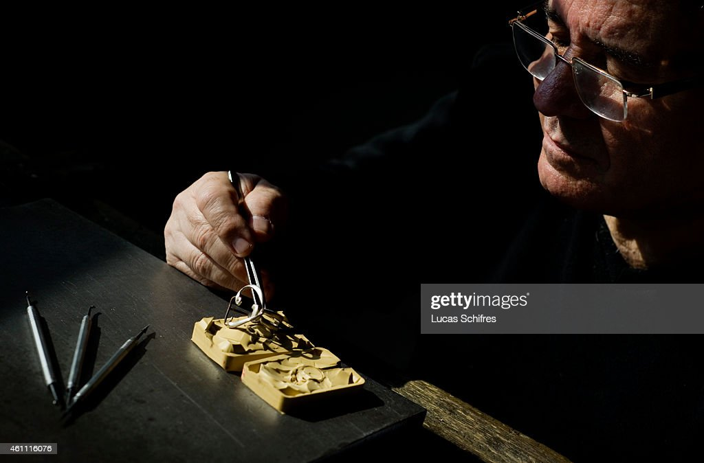 A Ganaelle jewelry craftsman works on a ring to make a jewel at his workstation at a Ganaelle Jewelry workshop on January 28, 2011 in Panyu, Guangzhou, China.