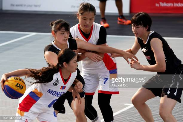 Ganbat Minjin of Mongolia is checked by Miyashita Kiho of Japan during the Women's Basketball 3x3 round robin pool B competition match between...