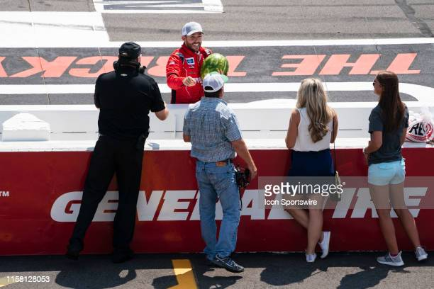Gander Outdoors Truck Series driver Ross Chastain of the Niece Motorsports Chevrolet Silverado gets a watermelon after winning the Gander Outdoors...