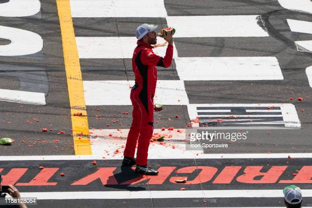 Gander Outdoors Truck Series driver Ross Chastain of the Niece Motorsports Chevrolet Silverado eats a piece of watermelon after winning the Gander...
