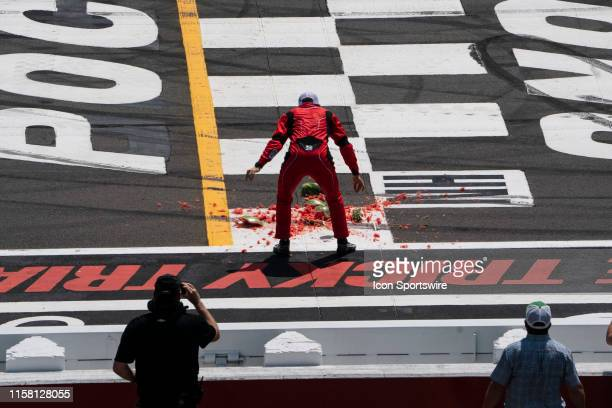Gander Outdoors Truck Series driver Ross Chastain of the Niece Motorsports Chevrolet Silverado smashes a watermelon on the start finish line after...