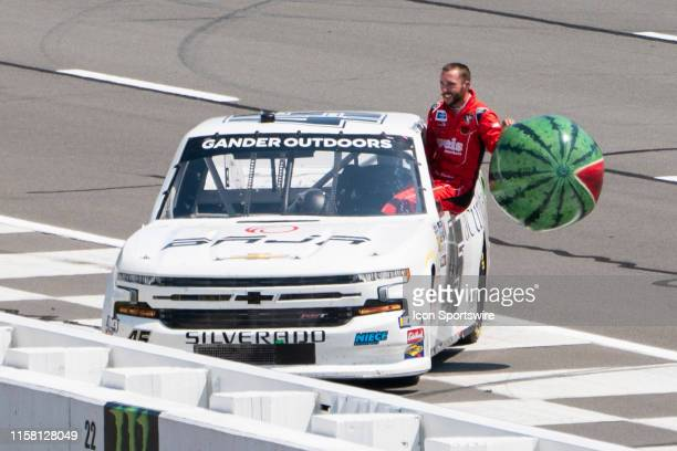 Gander Outdoors Truck Series driver Ross Chastain of the Niece Motorsports Chevrolet Silverado climbs back into his truck with a watermelon balloon...