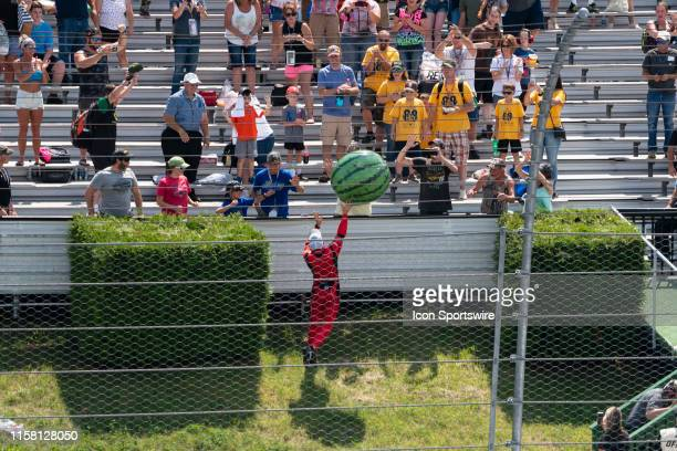 Gander Outdoors Truck Series driver Ross Chastain of the Niece Motorsports Chevrolet Silverado throws the watermelon beach ball to the crowd after...