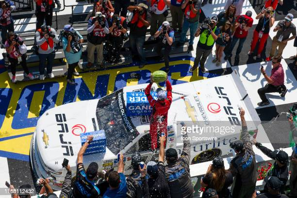 Gander Outdoors Truck Series driver Ross Chastain of the Niece Motorsports Chevrolet Silverado holds up a watermelon and celebrates victory after...
