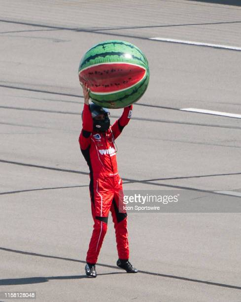 Gander Outdoors Truck Series driver Ross Chastain of the Niece Motorsports Chevrolet Silverado hold up a watermelon balloon after winning the Gander...