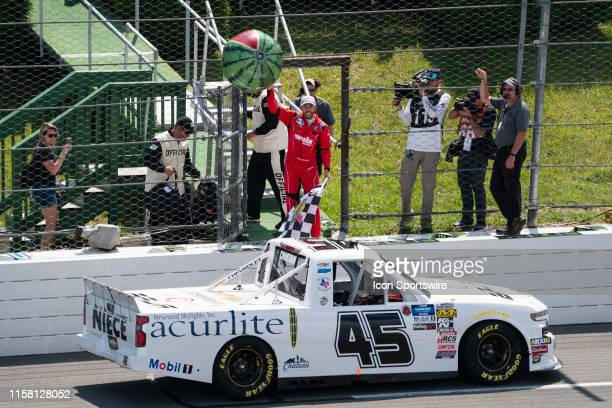 Gander Outdoors Truck Series driver Ross Chastain of the Niece Motorsports Chevrolet Silverado holds up the watermelon beach ball and the checkered...