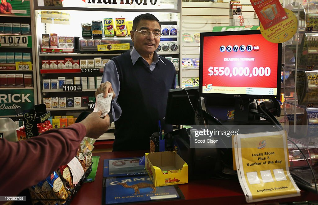 Gandhi Amrutlal sells a Powerball lottery ticket at his One Stop Mart store on November 28, 2012 in Chicago, Illinois. The jackpot for the Powerball lottery game rose $50 million today, to $550 million,