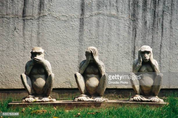 gandhi's famous monkeys at sabarmati ashram in ahmedabad, gujarat, india. - see no evil hear no evil speak no evil stock pictures, royalty-free photos & images
