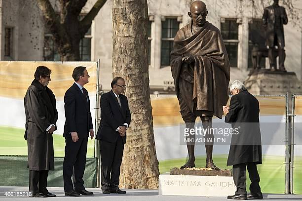 Gandhi's grandson Shri Gopalkrishna Gandhi salutes a recently unveiled statue of Mahatma Gandhi in Parliament square in central London on March 14...