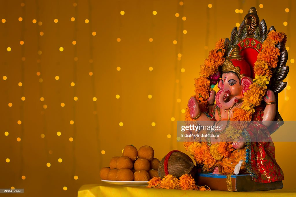 Ganesh idol and laddus : Stock Photo