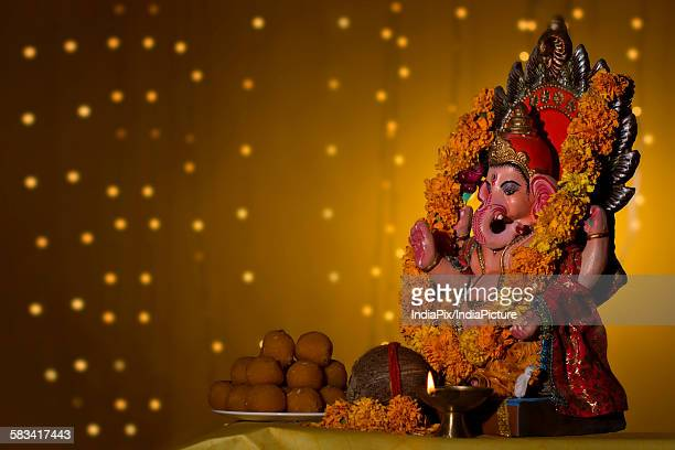 ganesh idol and laddus - mithai stock pictures, royalty-free photos & images