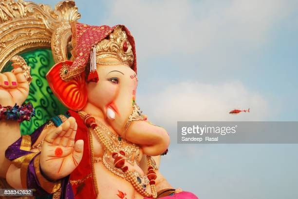 ganesh idol waiting to get immersion - ganesh chaturthi stock photos and pictures