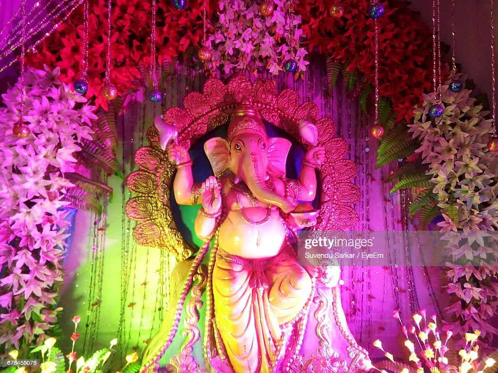 Ganesh Statue Amidst Flower Decorations During Festival : Stock Photo