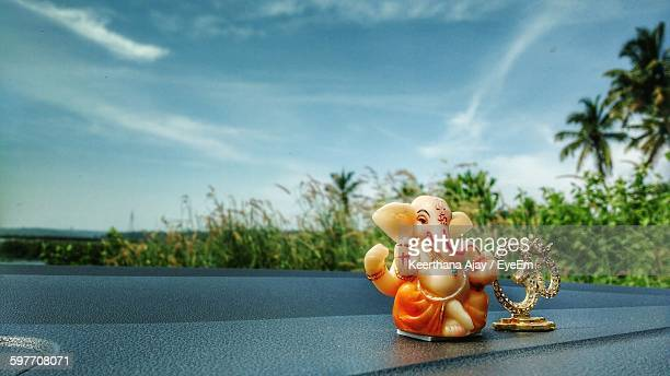 ganesha and om symbol on car dashboard - ganesha stock photos and pictures