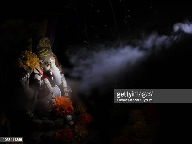 ganesha idol in darkroom - god stock pictures, royalty-free photos & images