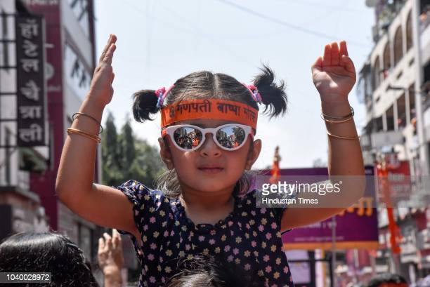 Ganesha procession on Laxmi Road on the last day of Ganesh Chaturthi festival, on September 23, 2018 in Pune, India. The Ganesh Chaturthi festival is...