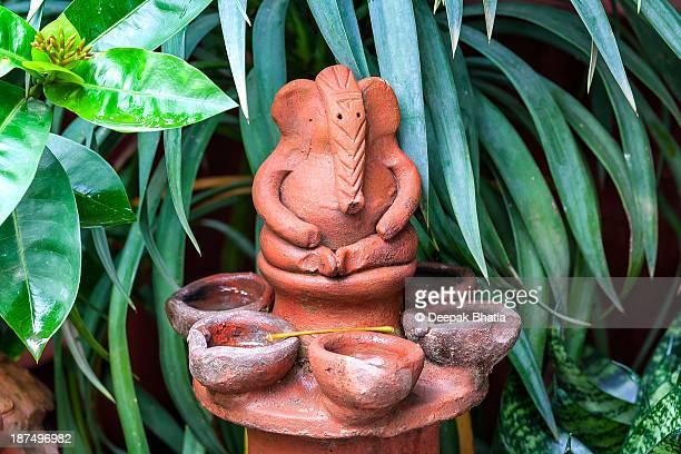 Ganesha relaxing among plants