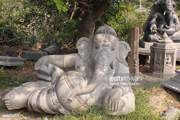 ganesha statues in park - ganesha stock photos and pictures