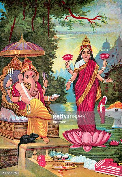 Ganesha, the elephant-headed, four-armed Hindu god that is worshiped as the remover of obstacles, with Lakshmi, the Hindu goddess of wealth and good...
