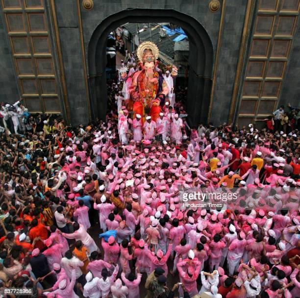 Ganeshotsav Devotees carry a statue of the god Ganesh for immersion in the sea on the last day of Ganesh Chaturthi at Lalbaugh in Mumbai