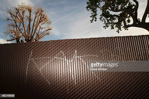 Gang graffiti is seen on a fence March 3 2009 in Compton California The city that became known as the birthplace of gangsta rap and was once one of...