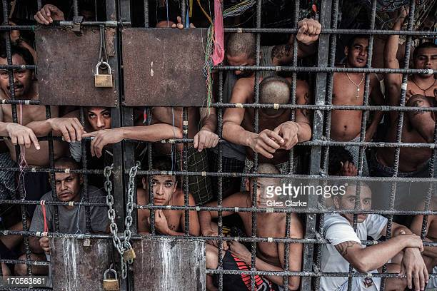 Gang members languish in one of the three 'gang cages' in the Quezaltepeque police station May 20, 2013 in San Salvador, El Salvador. These...