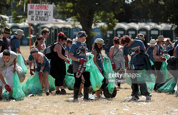 A gang of litter pickers work on a campsite as festivalgoers leave the 40th Glastonbury Festival at Worthy Farm Pilton on June 28 2010 in Glastonbury...