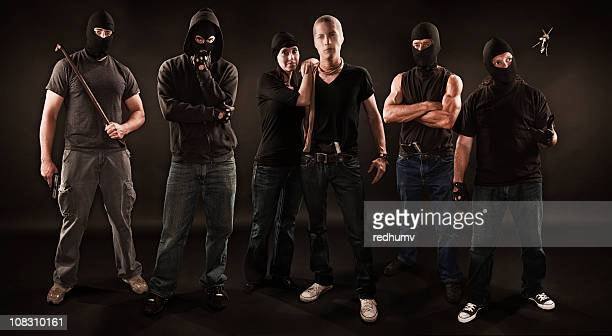 gang of robbers - gang stock pictures, royalty-free photos & images
