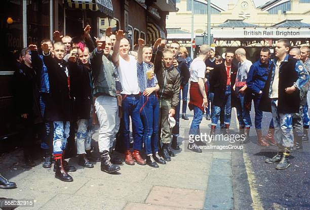Gang of skinheads giving the salute outside the pub Brighton UK 1980's