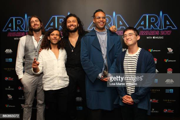 Gang of Youths pose in the awards room with an ARIA for Best Rock Album and Album of the Year during the 31st Annual ARIA Awards 2017 at The Star on...